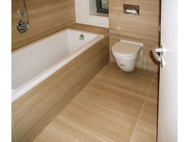 Nhà tắm đá xám vân gỗ